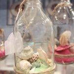Botella con arena y conchas de Unimasa